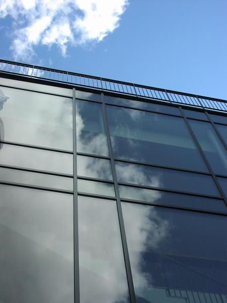 Closeup of glass building with blue sky : Free Stock Photo