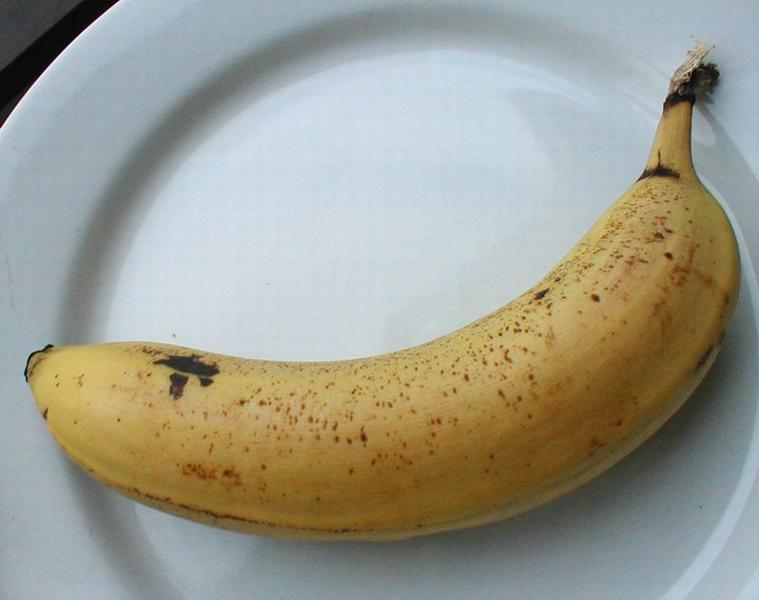 Closeup of a banana on a white plate : Free Stock Photo