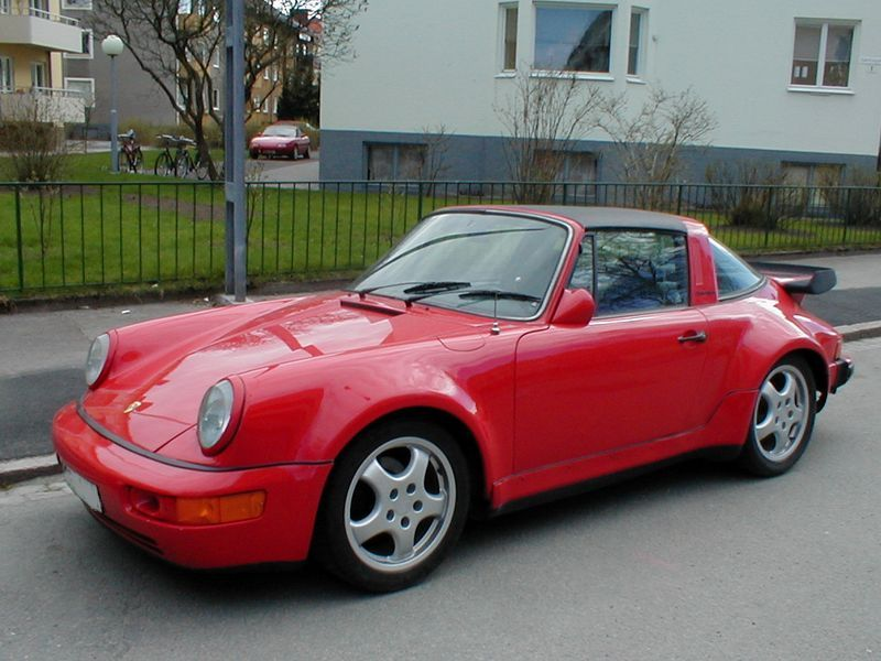 A red porsche parked along the curb : Free Stock Photo