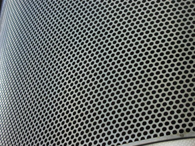 Closeup of a metal grate : Free Stock Photo