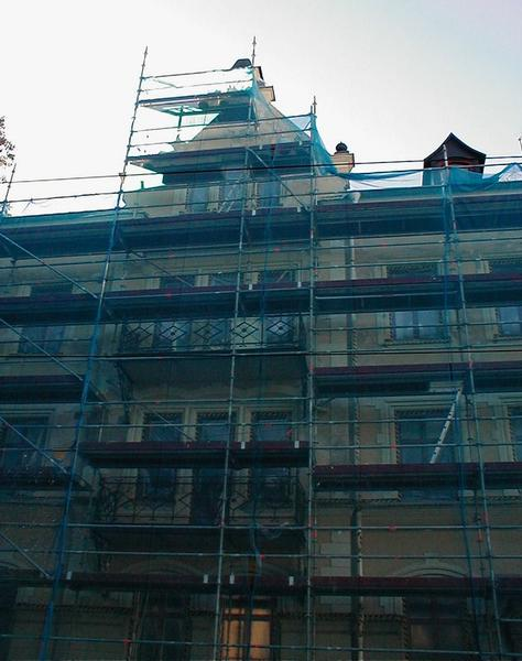 Face of large home with scaffolding under construction : Free Stock Photo