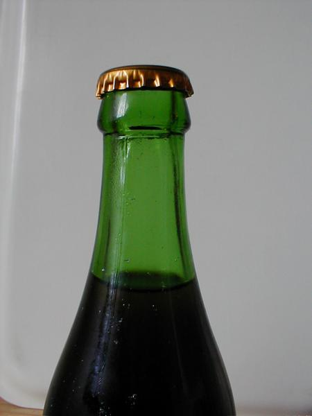 Closeup of a green beer bottle neck : Free Stock Photo