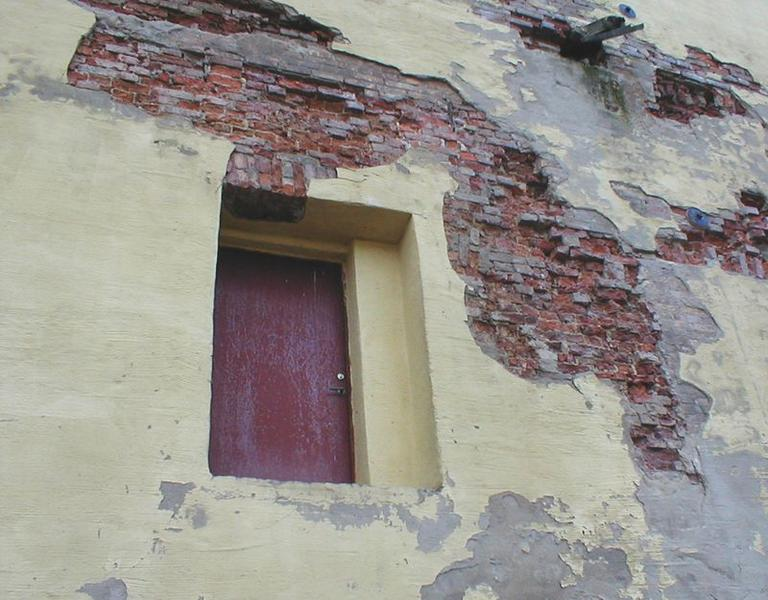 Wall and door of an old brick home : Free Stock Photo