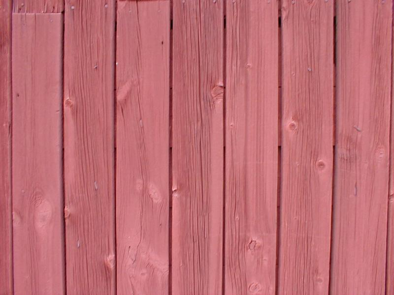 Closeup of red stained wooden fence or wall : Free Stock Photo