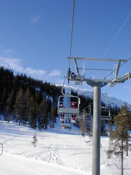 A chair lift climbing a ski mountain : Free Stock Photo