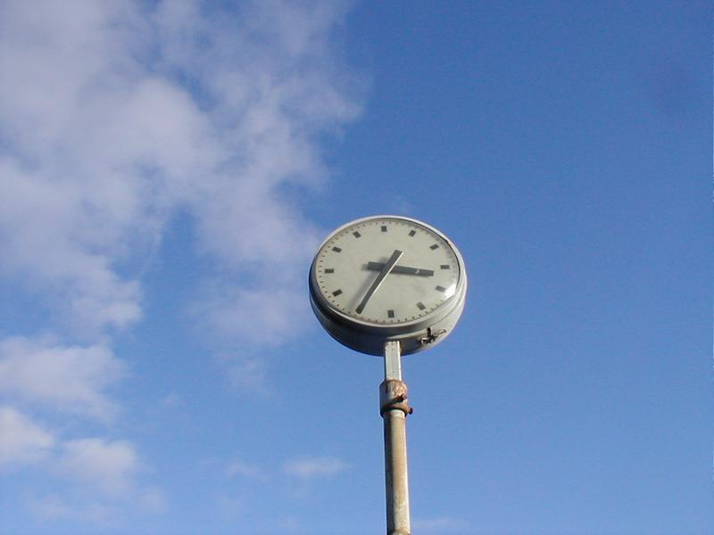 An outdoor clock with a blue sky background : Free Stock Photo