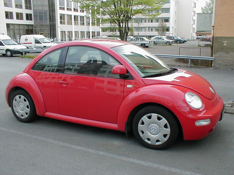 A red Volkswagon Beetle parked : Free Stock Photo