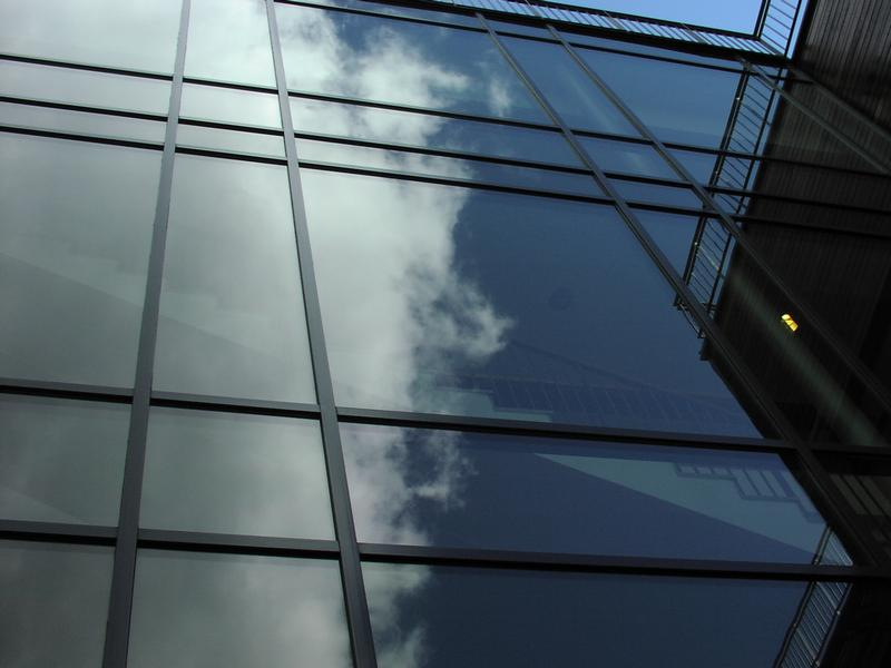 Sky reflecting on a modern glass building : Free Stock Photo