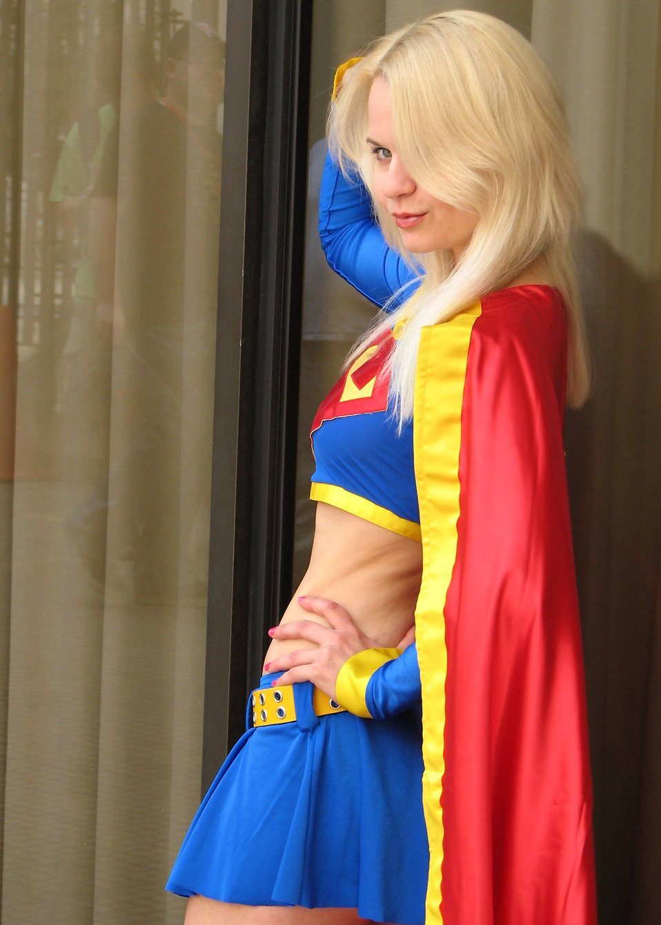 Beautiful woman posing in a Supergirl costume at Dragoncon : Free Stock Photo