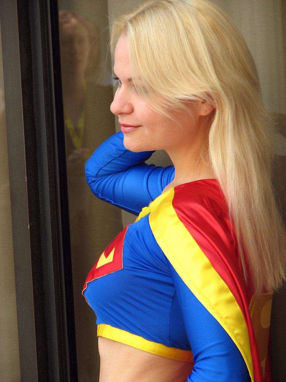 Closeup portrait of woman posing as Supergirl : Free Stock Photo