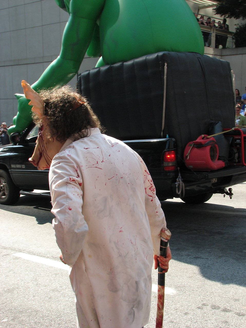 Man in bloody pig costume by float in 2008 Dragoncon parade : Free Stock Photo