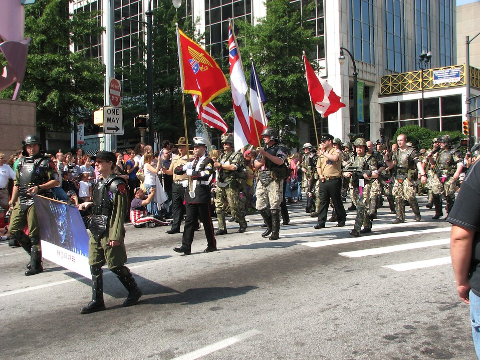 Soldiers marching with flags in the 2008 Dragoncon parade in Atlanta, Georgia.