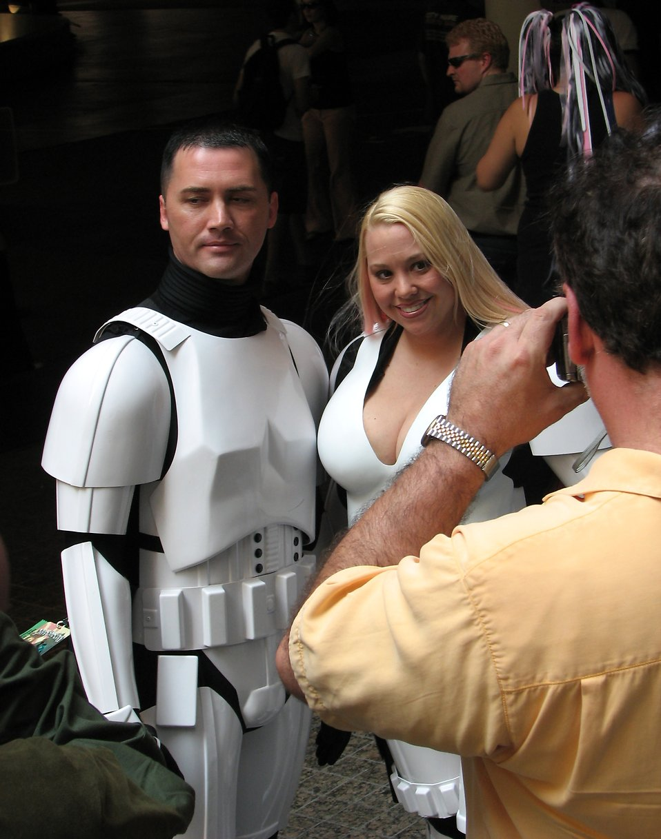 Attractive man and women in Stormtrooper costumes posing at Dragoncon 2008 : Free Stock Photo