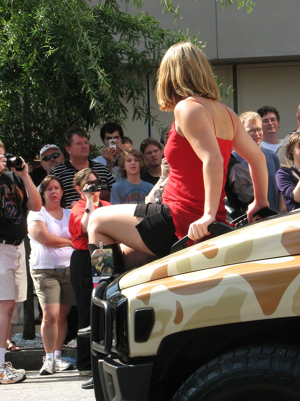Girl on the hood of a military truck in 2008 Dragoncon parade : Free Stock Photo