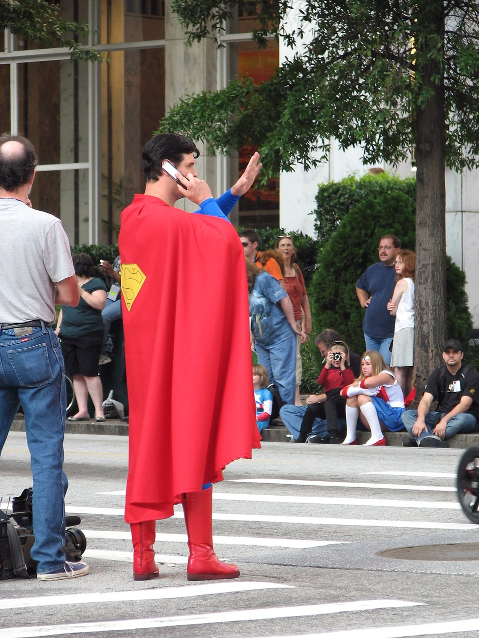 Superman on a cell phone crossing the street at 2008 Dragoncon parade : Free Stock Photo