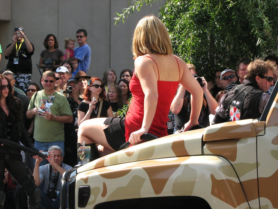 Beautiful girl on the hood of truck in 2008 Dragoncon parade : Free Stock Photo