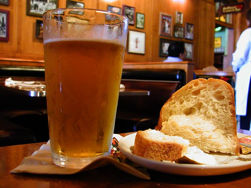 A glass of beer and bread in a bar : Free Stock Photo