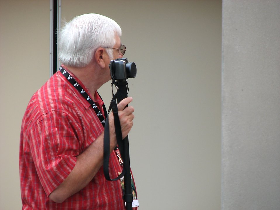 Older man with camera on a monopod at 2008 Dragoncon parade : Free Stock Photo