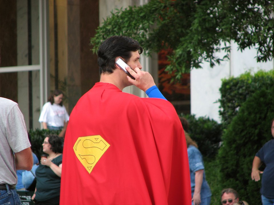 Man in Superman costume on cell phone at Dragoncon 2008 : Free Stock Photo