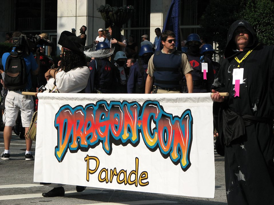 Men in costumes holding flag in the 2008 Dragoncon parade : Free Stock Photo
