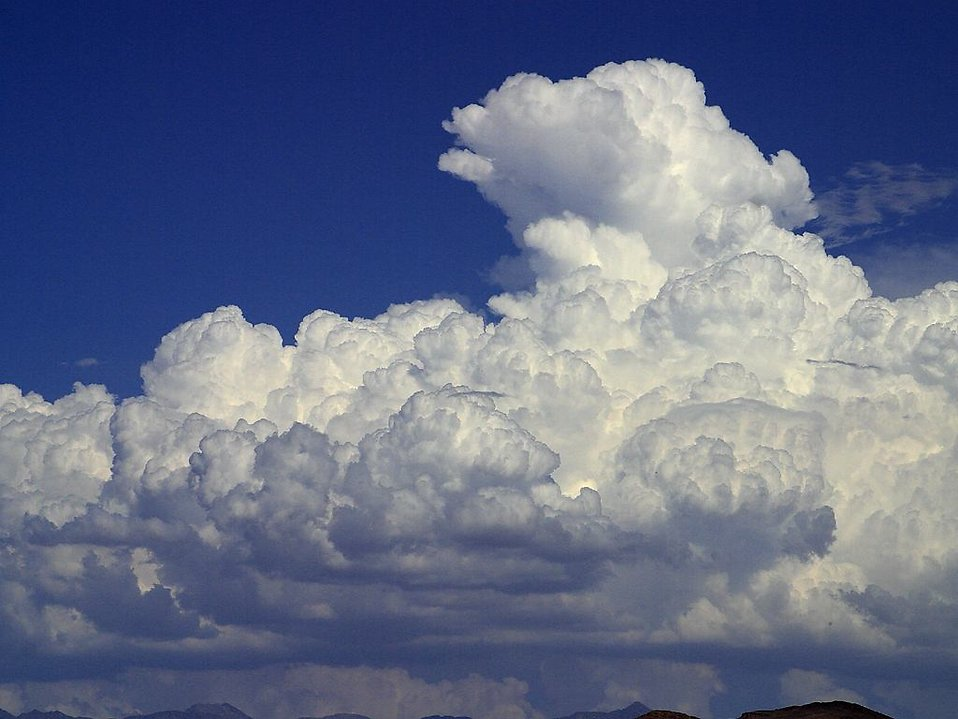 Thick White Clouds In A Blue