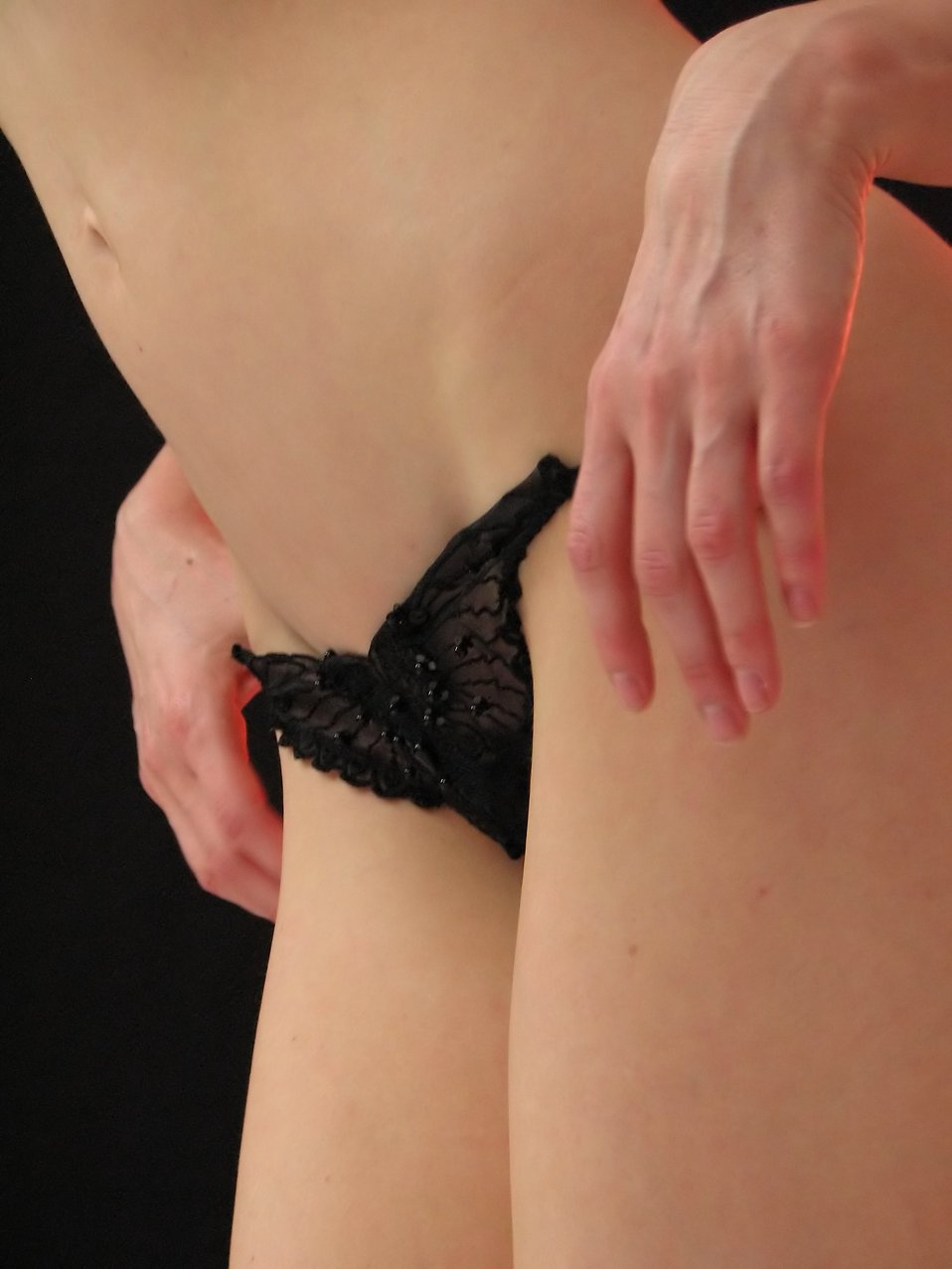 Closeup of a woman's body wearing black lingerie : Free Stock Photo