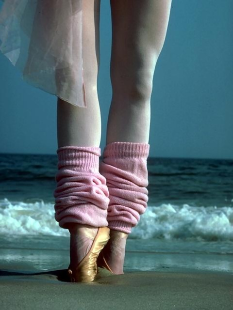 Closeup of a ballerina's legs and feet on a beach : Free Stock Photo
