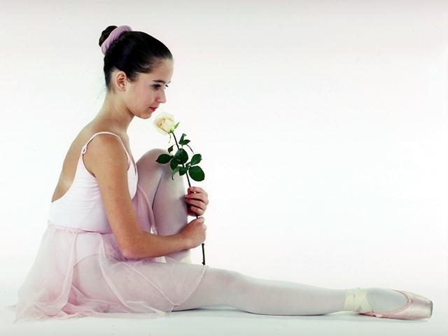 A young ballerina posing on the floor with a yellow rose : Free Stock Photo