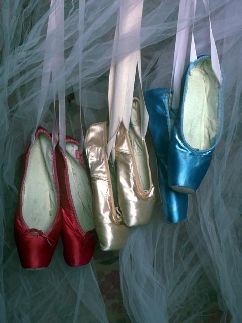 Three pair of ballet slippers hanging by ribbons : Free Stock Photo