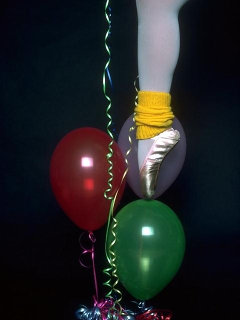 Closeup of a ballerina's leg and slipper with balloons : Free Stock Photo