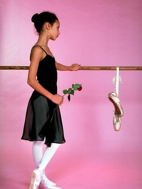 Young ballerina posing with slippers and a rose : Free Stock Photo