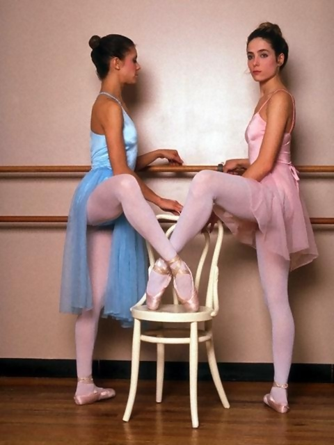 Two beautiful young ballerinas posing with a chair : Free Stock Photo