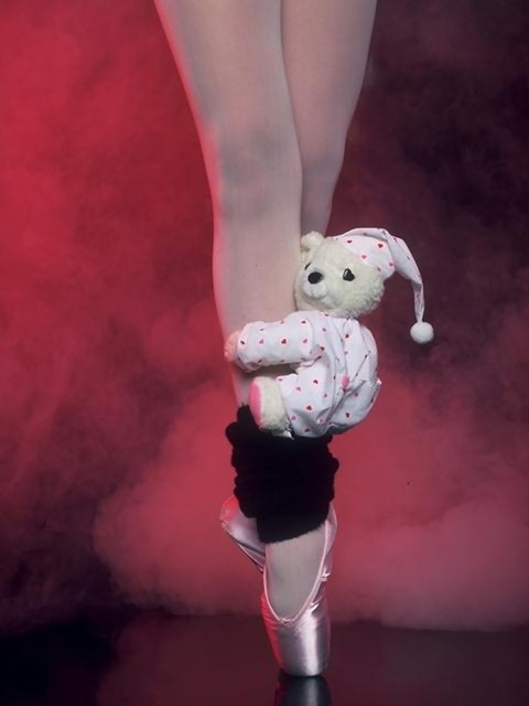 Closeup of a ballerina's legs and slippers with a teddy bear : Free Stock Photo