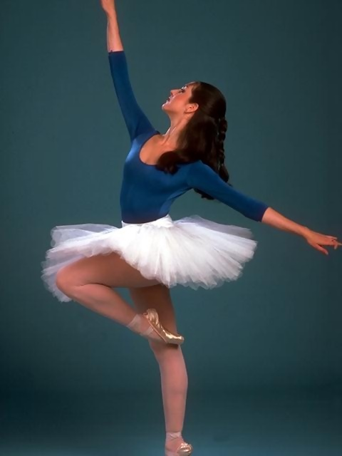 A ballerina posing with a blue background : Free Stock Photo
