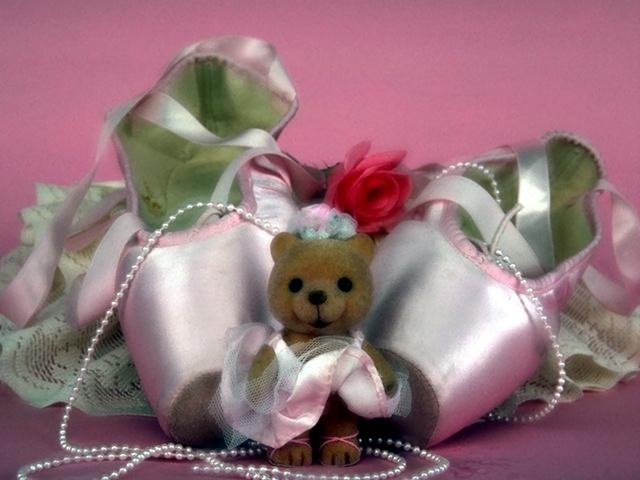 A pair of ballet slippers with a teddy bear and a rose : Free Stock Photo