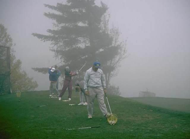 A group of seniors driving golf balls in the fog : Free Stock Photo