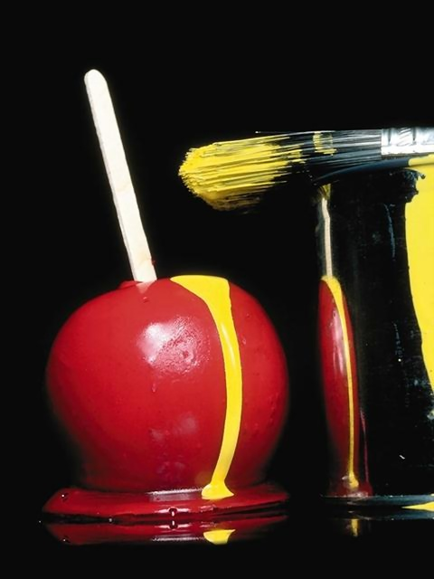 Candy apple with yellow paint dripping on it : Free Stock Photo