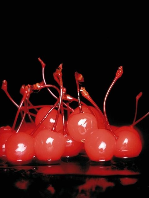 A group of moist cherries on a black background : Free Stock Photo