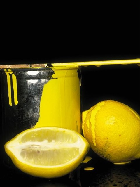 Sliced lemons and a bucket of yellow paint : Free Stock Photo