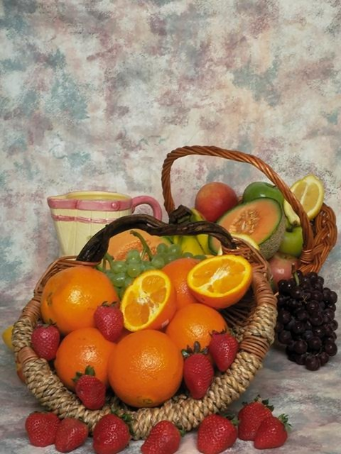 A display of mixed fruit baskets : Free Stock Photo