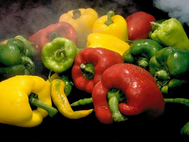 Close-up of various peppers with steam : Free Stock Photo