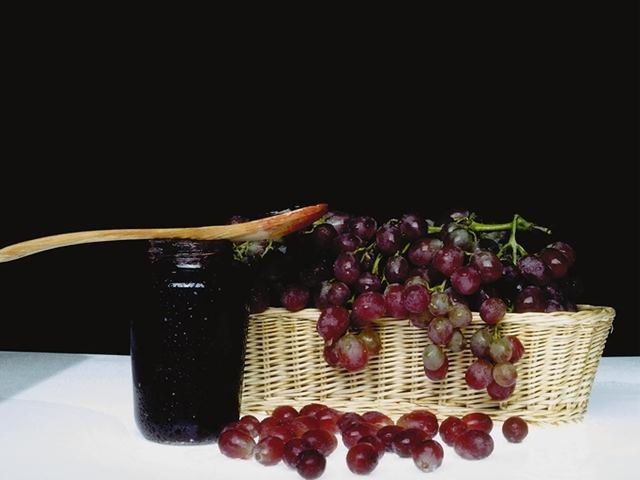 A basket of grapes and a jar : Free Stock Photo