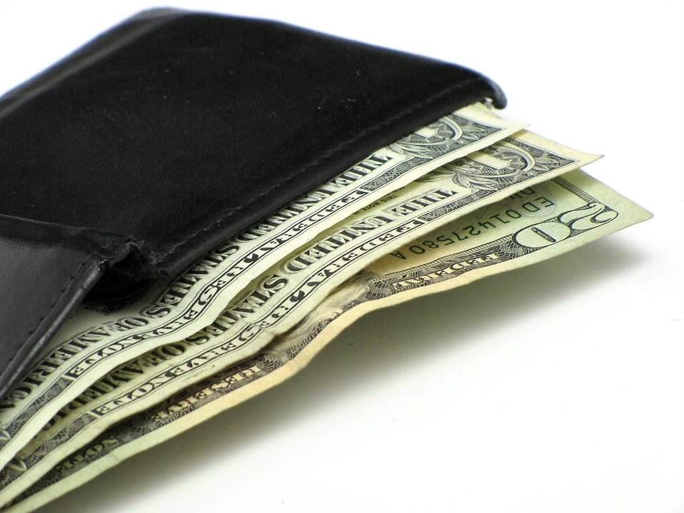 Dollar bills in a black wallet : Free Stock Photo