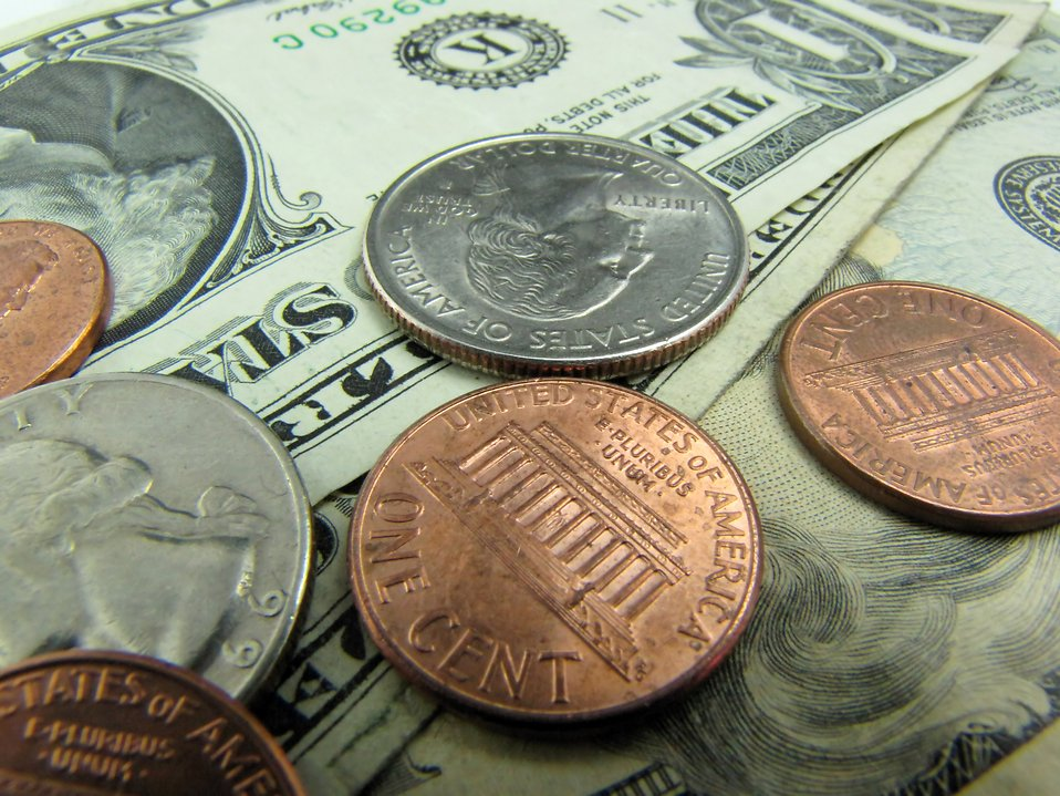Close-up of US dollars and coins : Free Stock Photo