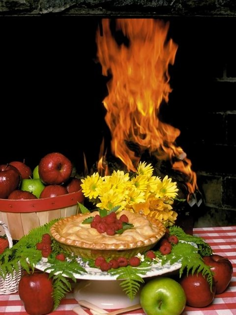 Display of apples and a pie in front of a fire : Free Stock Photo