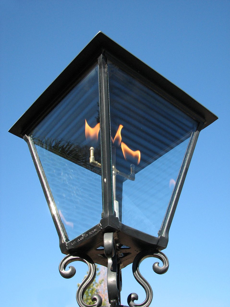 Closeup of a gas flame lamp post : Free Stock Photo