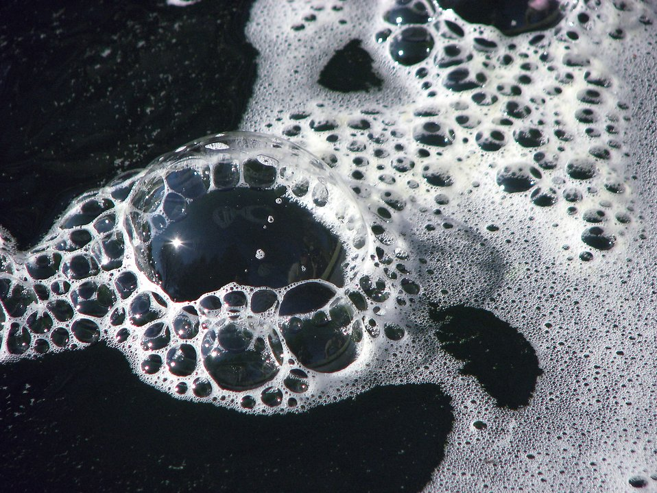 Large bubbles floating on top of water : Free Stock Photo