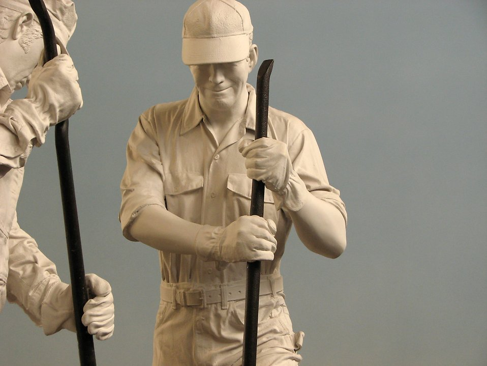 Statues of men working on train tracks : Free Stock Photo