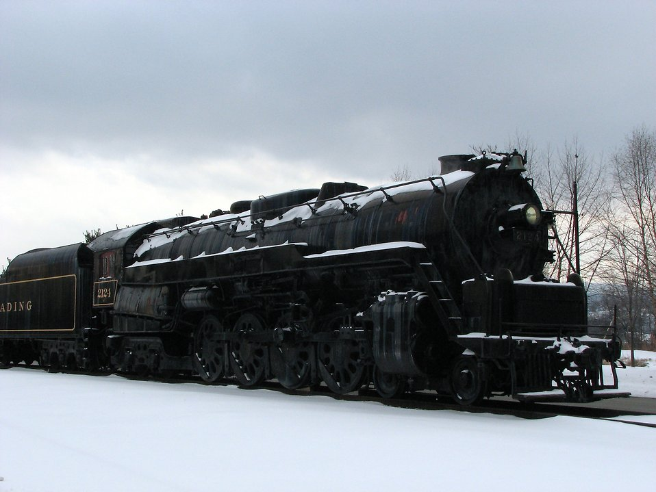 A steam locomotive under a stormy winter sky : Free Stock Photo