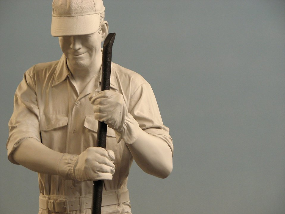 Closeup of a statue of a man working on train tracks : Free Stock Photo